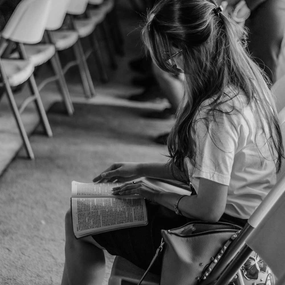 woman studying bible in group
